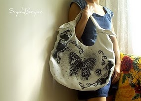 Win a $30 shop credit for a handpainted purse!!